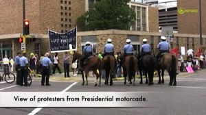 View of protesters from Presidential motorcade