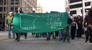 "The message ""Corporate Greed Is Killing Us"" resonates with average citizens"