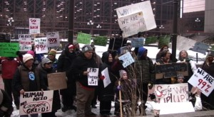 Under court order, Occupy MN returns to re-sign the plaza.