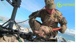 AFN worker installs satellite dish in Afghanistan so US troops can watch Super Bowl