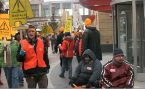Non-union cleaners picket outside Target headquarters